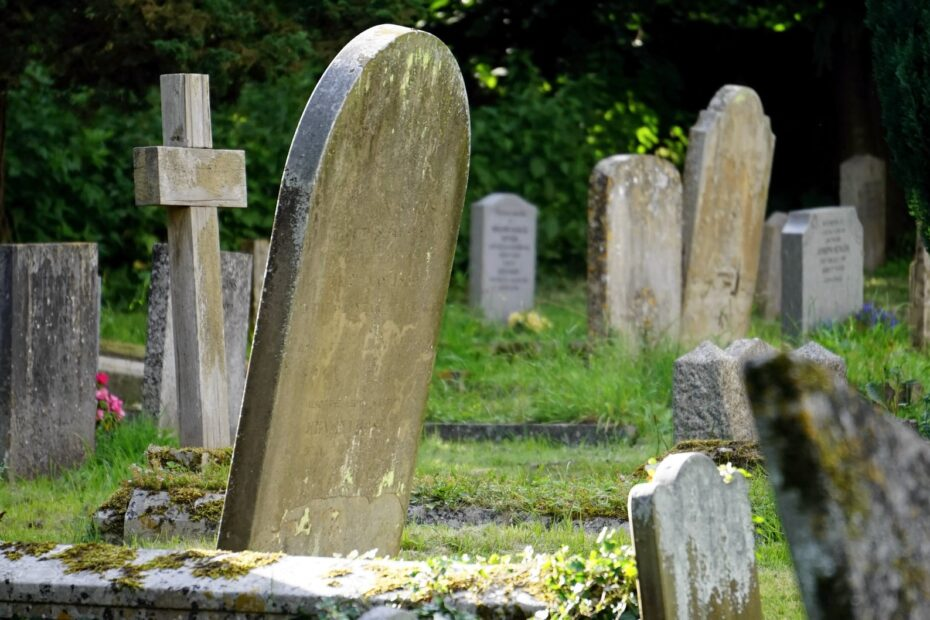 close up photography of concrete tombstones